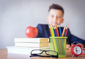Boy looking at desk