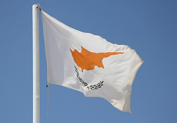 Cyprus flag against a blue sky